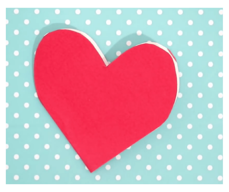 DIY VALENTINES DAY CARD- step-cut a heart shape out of the cardstock paper