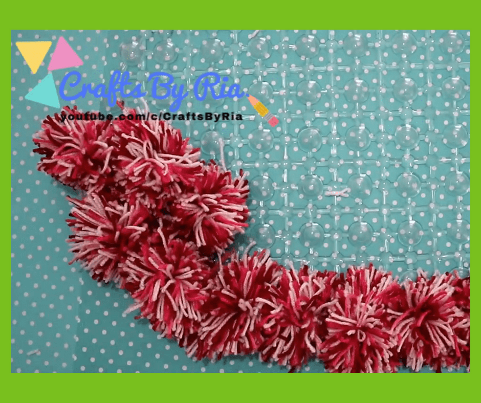 diy pom pom rug-steps-fasten the pom poms to the mat