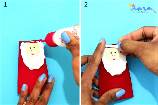 Step 4 to make toilet roll santa- stick a small white felt on top the head