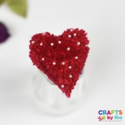 how to make a pom pom heart with beads-featured image
