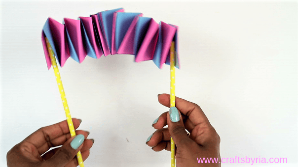 stick paper straw under the dragon puppet craft