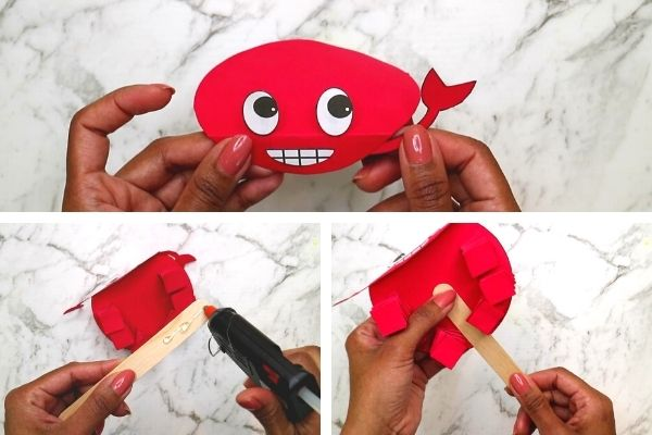 Stick the crab's antennae and a popsicle stick behind the bodyto make the walking crab craft puppet.