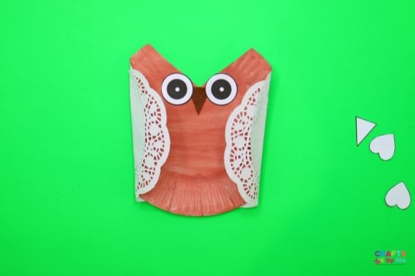 Stick the wings, beak and legs to make the easy owl craft