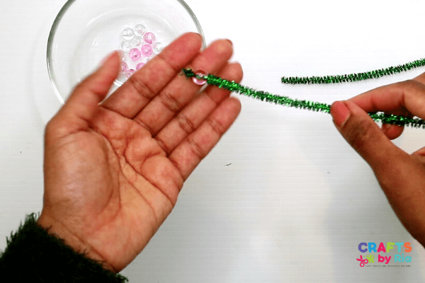 Make a tiny fold at the end of one of the pipe cleaners to stop the beads from falling off.