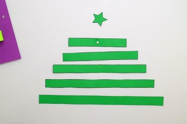 Cut out the rectangle and star shapes from the christmas card printable for kids